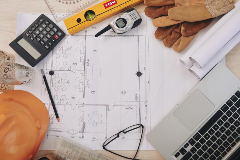 Building plan and contractor belongings around it